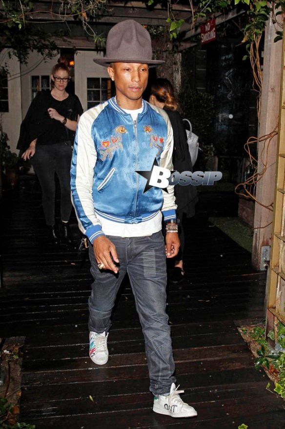 Pharrell Williams wears his signature hat to a celebration at Eveleigh